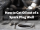 How to get oil out of a spark plug well